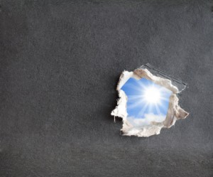 Hole with the fragmentary edges, punched in a cardboard